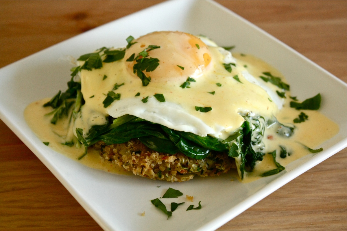 Zucchini cake Florentine with coconut oil hollandaise